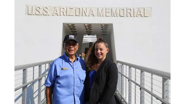 Student reporter Julia and Pearl Harbor eyewitness Jimmy Lee on the USS Arizona Memorial filming the Museum's 2016 Electronic Field Trip