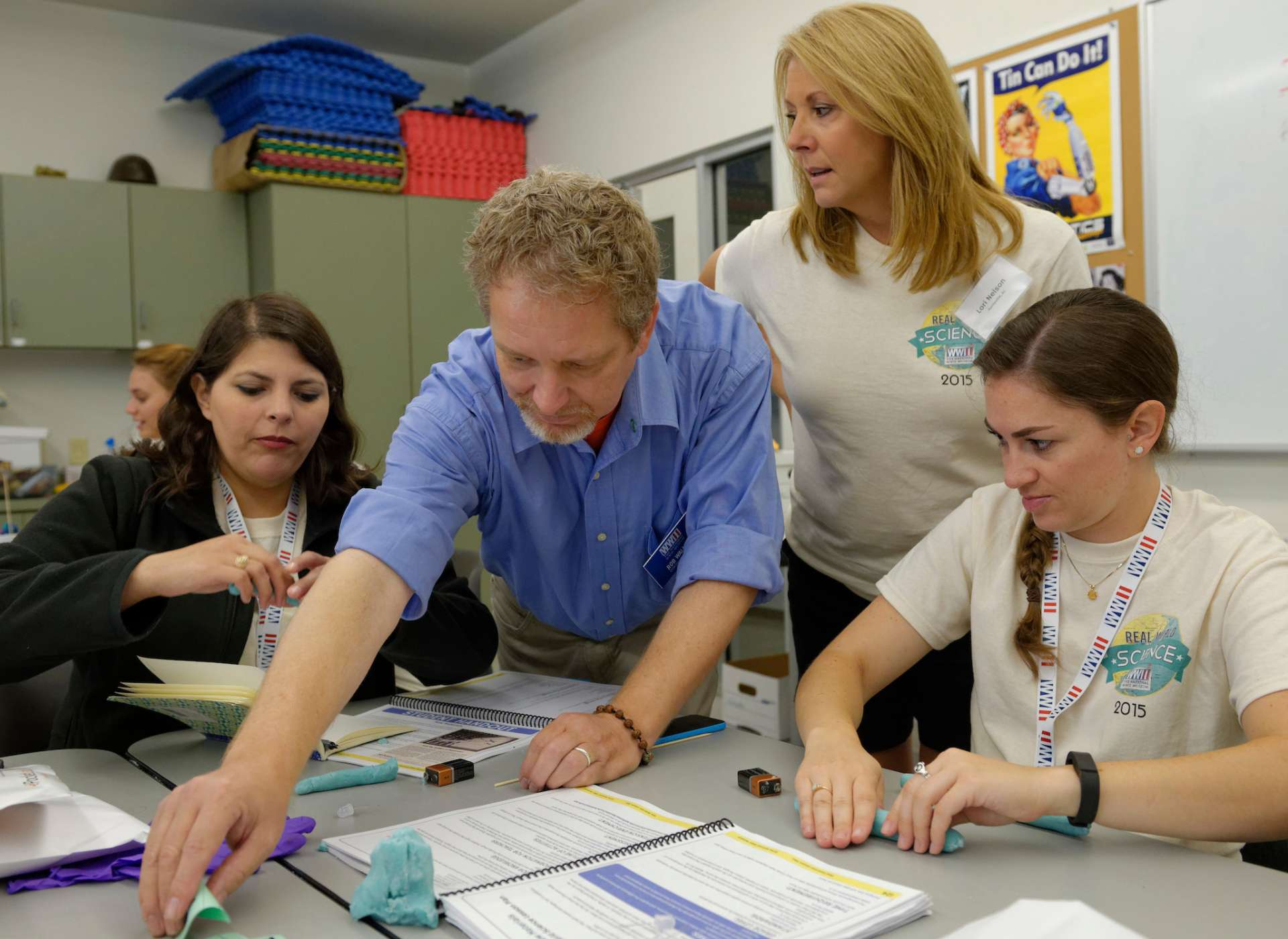 Teachers using classroom materials