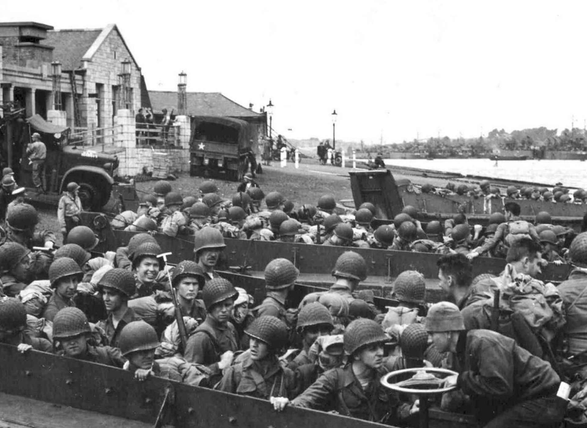 D-Day Invasion of Normandy gallery, photo of soldiers in boats on shores of Normandy