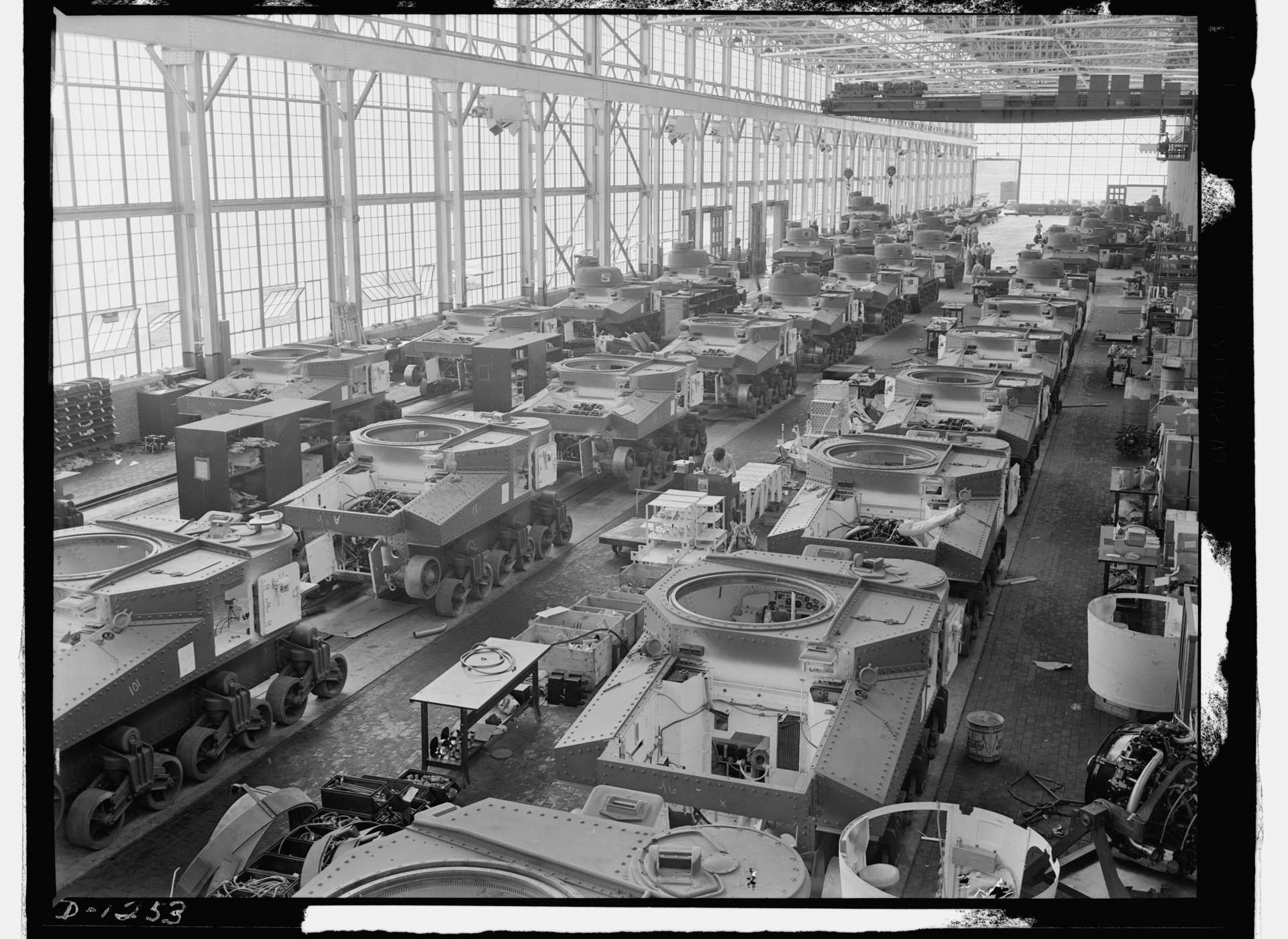 Tanks move along an assembly line that produced cars and trucks before the war at Chrysler in Detroit