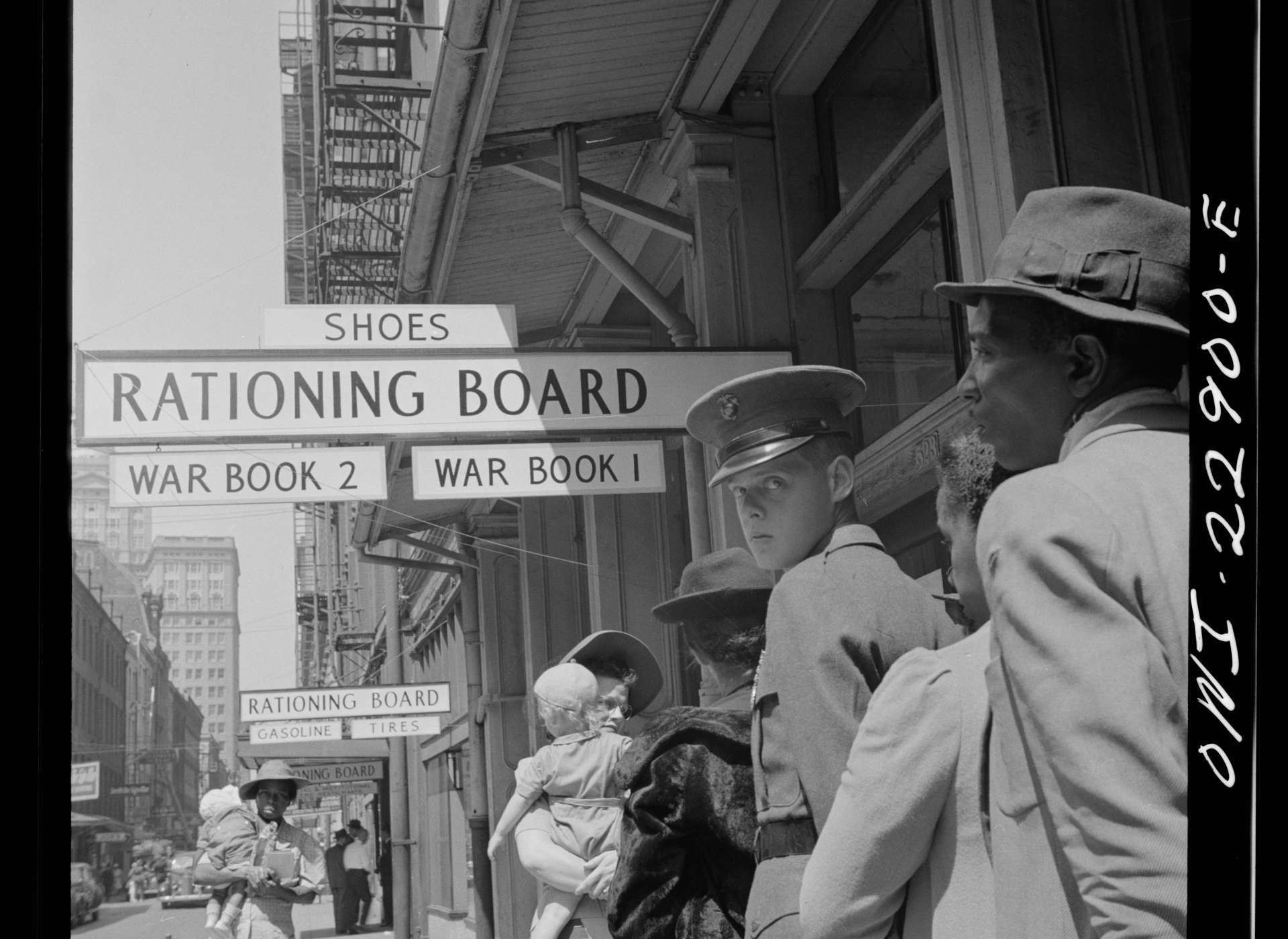 Citizens line up outside their local War Rationing Board office on Gravier Street in New Orleans, 1943.