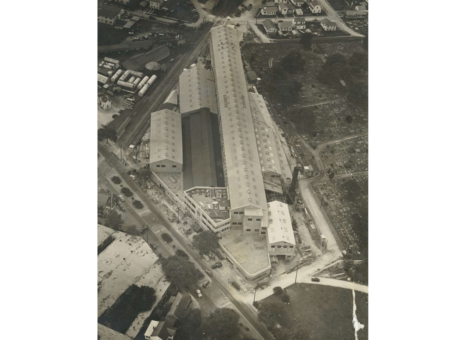 This May 1940 aerial photograph shows City Park Plant in the final stages of construction. When completed, City Park had one PT boat and two landing craft production lines. Higgins, without permission, built nearly 40 percent of the facility on property owned by Holt Cemetery. This property use was not resolved until after the end of World War II.
