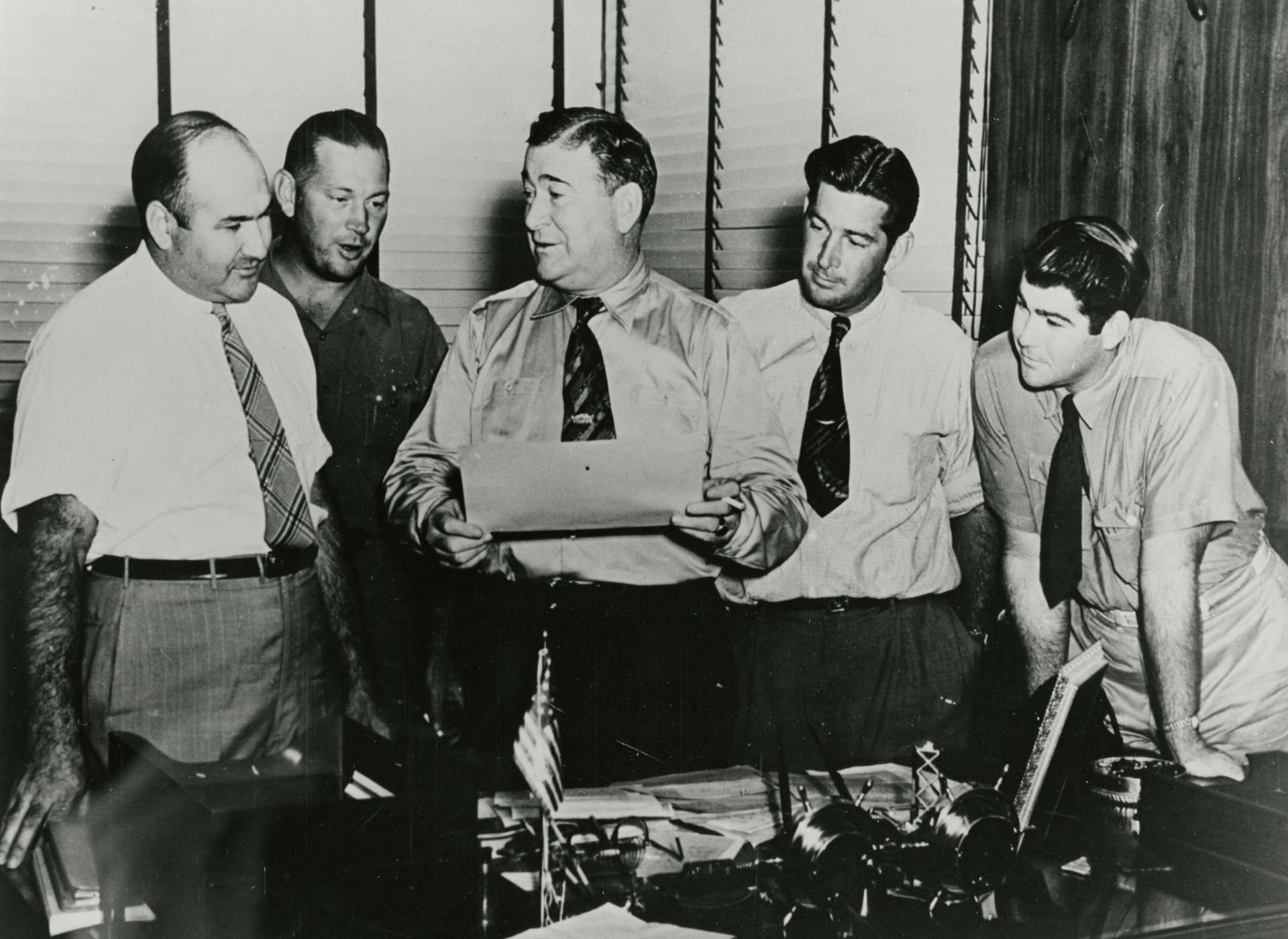 Andrew Higgins's oldest sons were heavily involved in Higgins Industries from the beginning. Higgins stands at center with his sons Ed, Andrew Jr., Frank, and Roland.