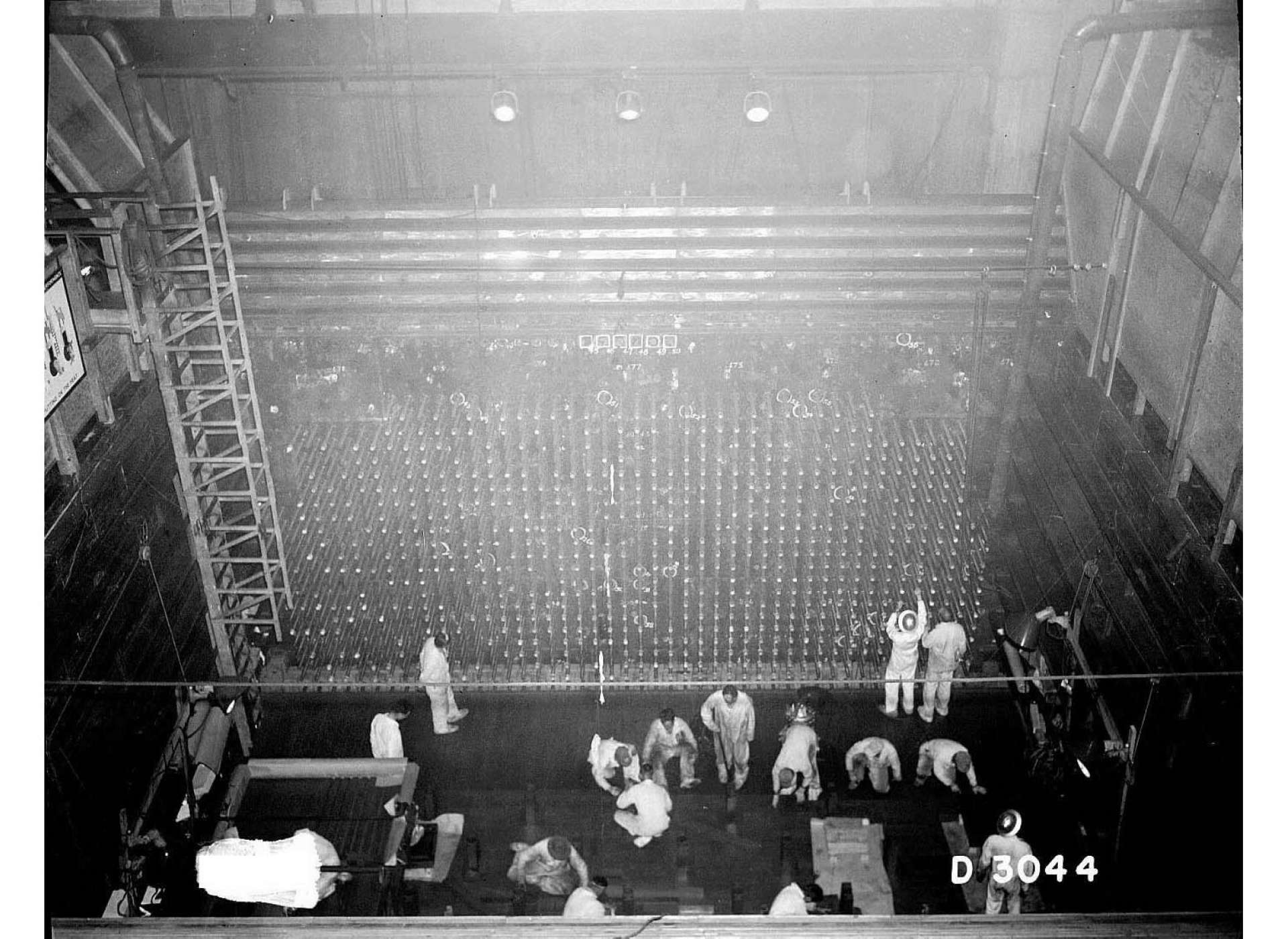 Men working near the face of B Reactor in 1944. Courtesy of The National Archives.