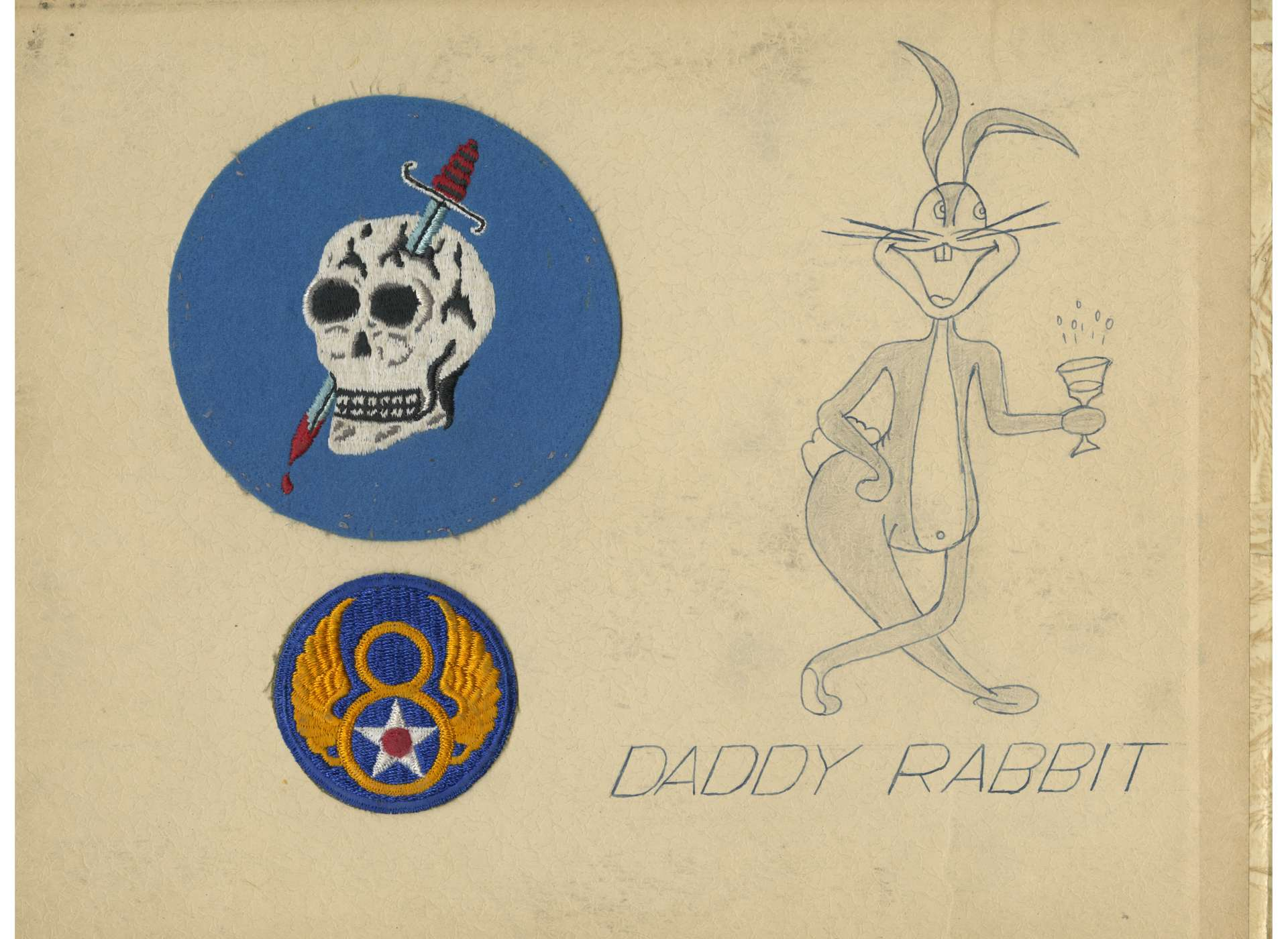 A page from Captain Charles K. Peters's scrapbook. Peters's 363rd Fighter Squadron and 8th Air Force patch are pasted inside, along with a sketch of Daddy Rabbit's nose art.