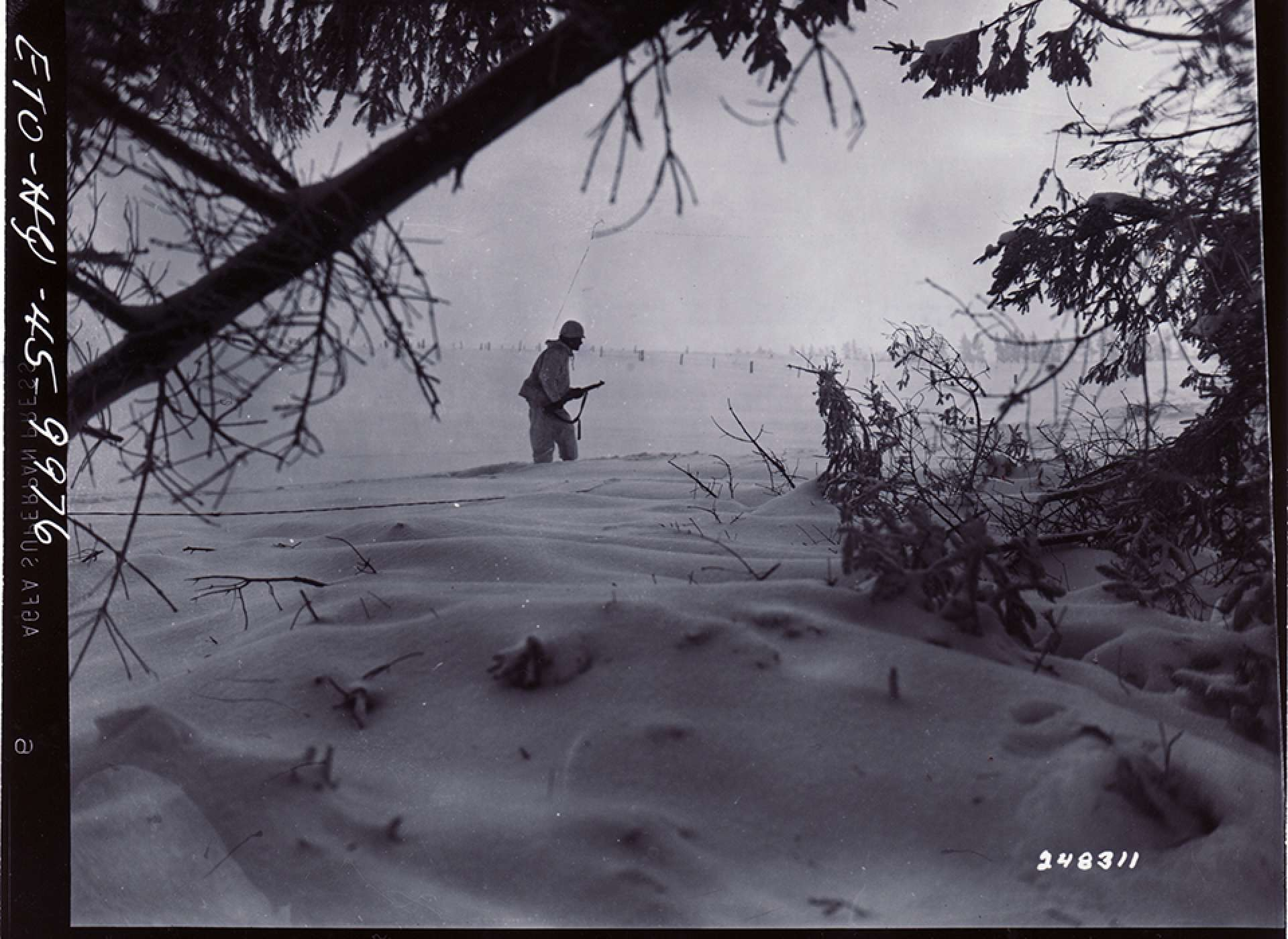 1st Infantry Division soldier on patrol near Bullingen, Belgium. The National WWII Museum Digital Collections.