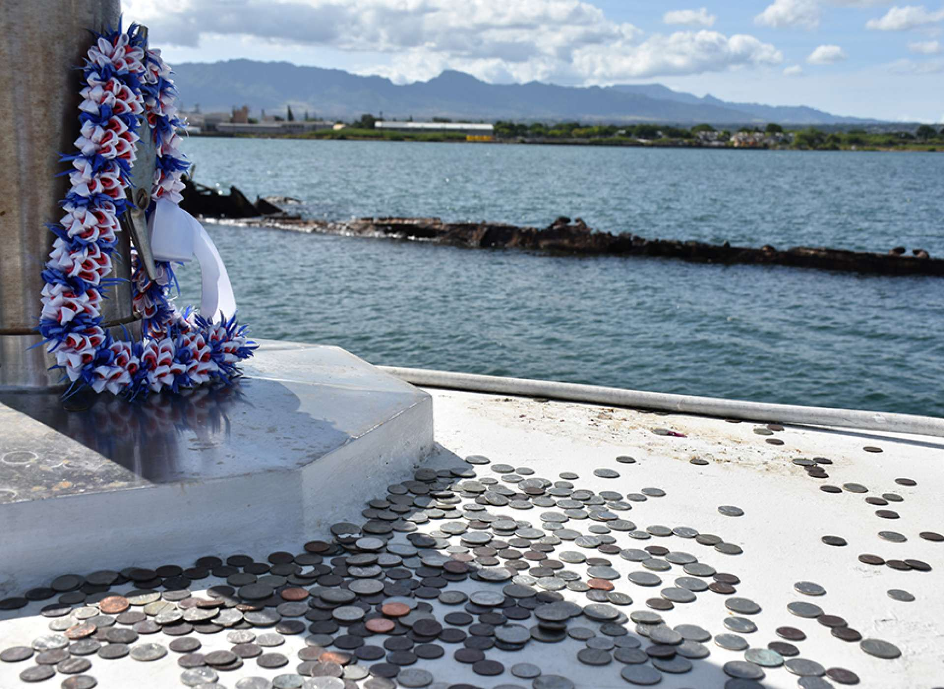 Coins and flowers at the USS Utah memorial on Ford Island, Pearl Harbor, Hawaii. Credit: Keith Huxen, PhD