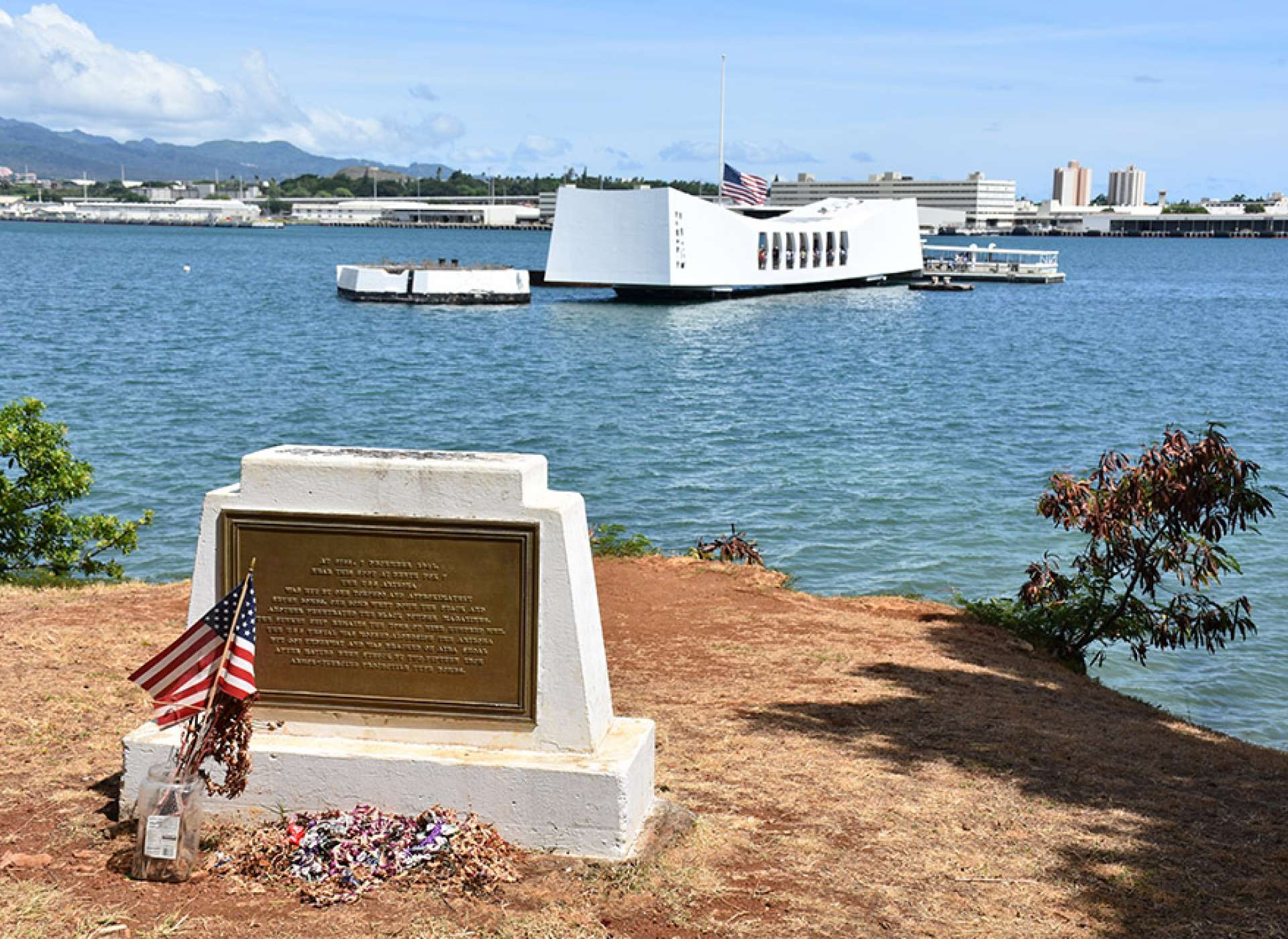 Coins atop the USS Arizona memorial on Ford Island, Pearl Harbor, Hawaii. Credit: Keith Huxen, PhD