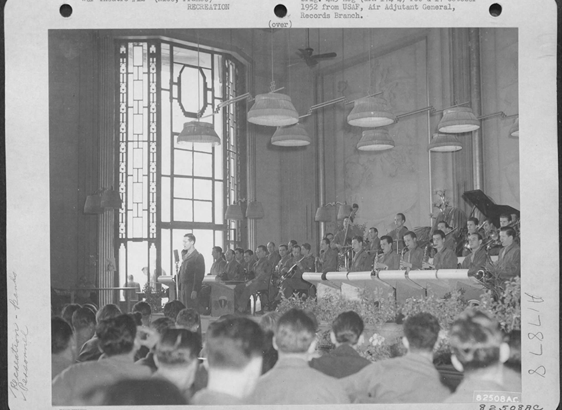 The Army Air Forces Band, directed by Ray MacKinley after Miller's disappearance, plays for GIs on leave in Nice, France, May 1945. US Air Force photograph.