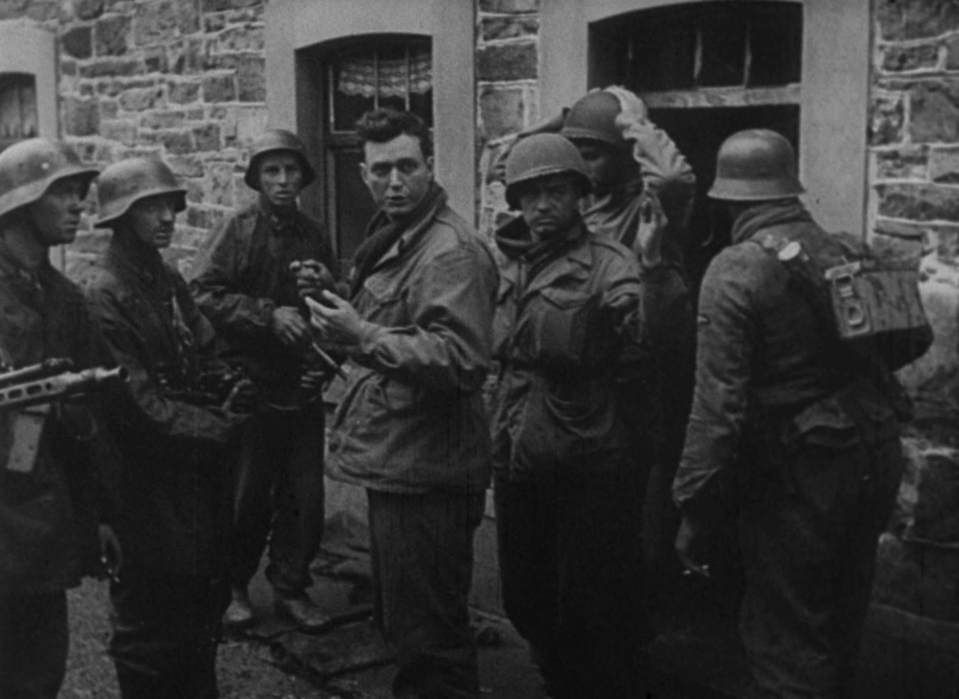 Americans come out of their defensive positions and surrender to Panzergrenadiers in Stoumont.