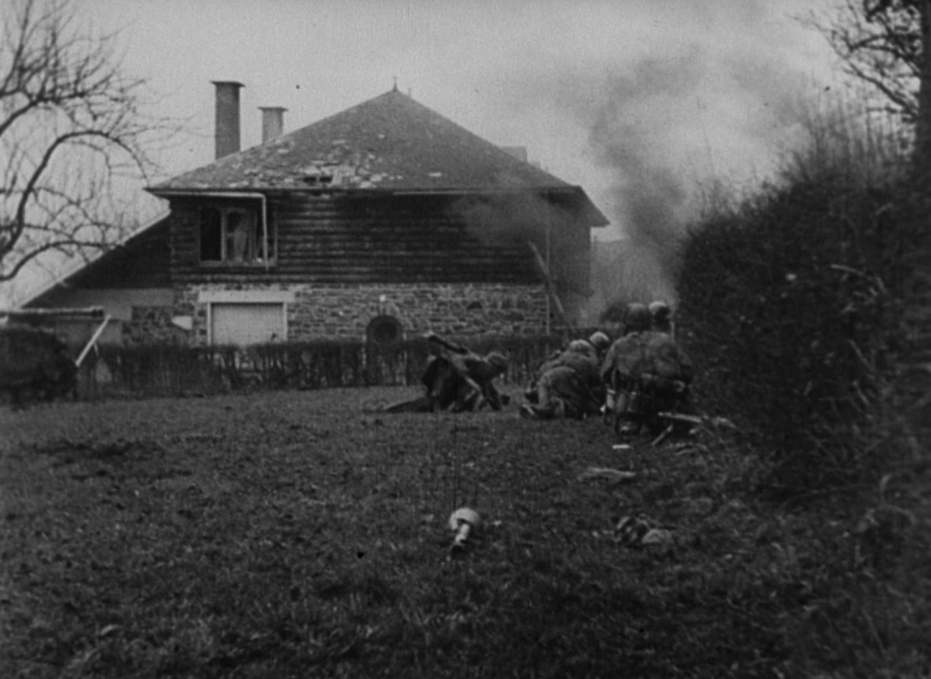 Fallschirmjager take cover from American fire as they attempt to aid a wounded man.