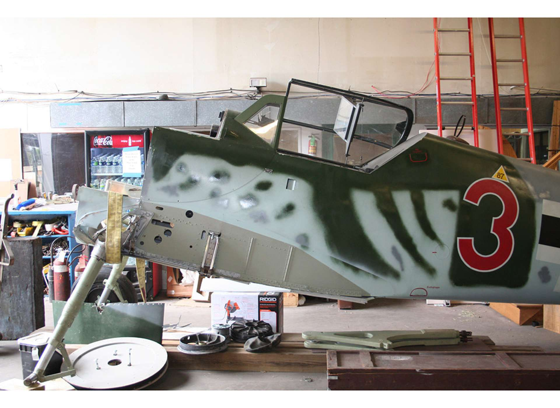 Bf 109 receives attention before moving to the Campaigns of Courage Pavilion.