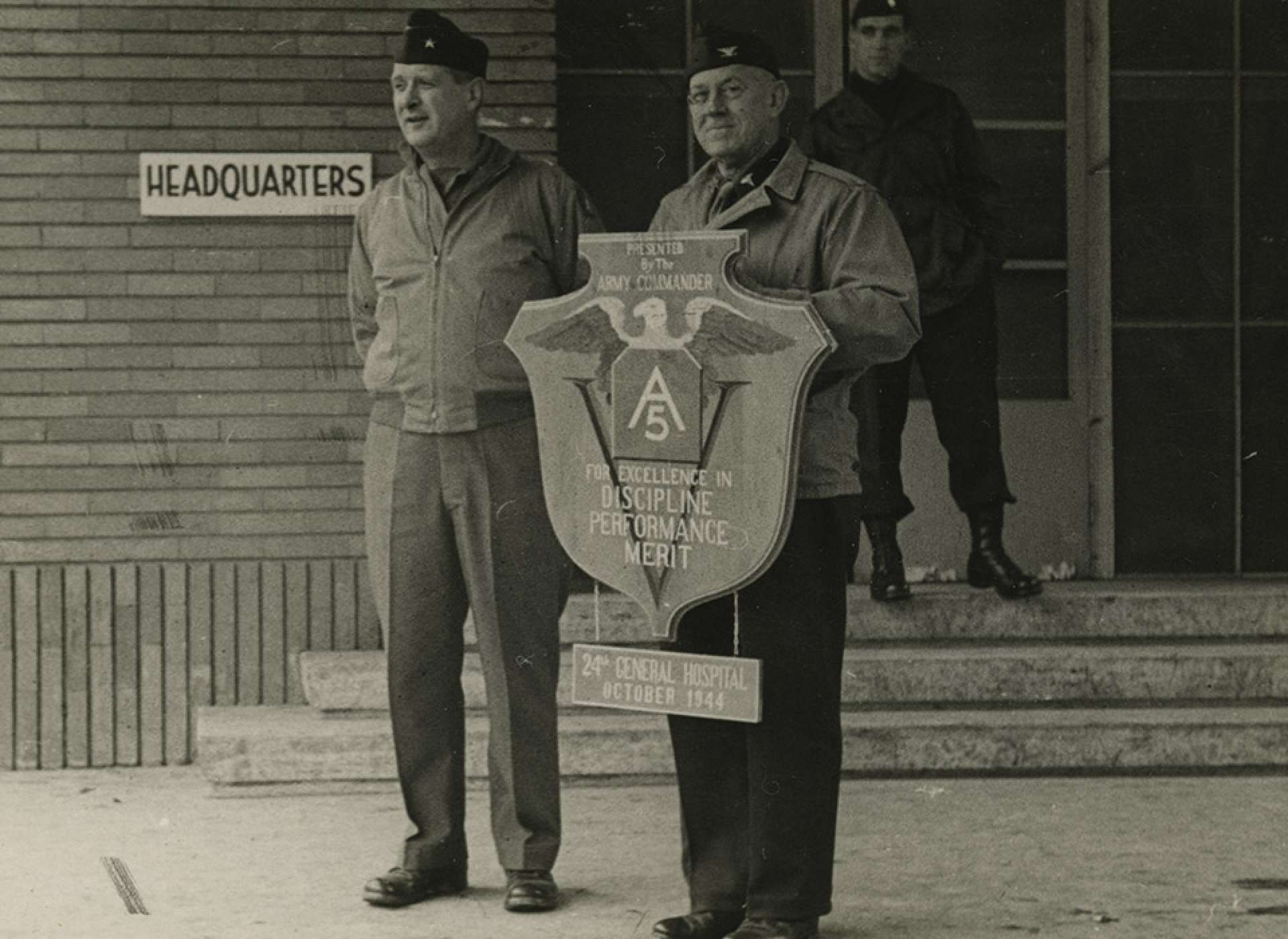 Colonel Walter Clifton Royals, Commanding Officer of the 24th General Hospital and Tulane doctor holds a plaque awarded to the Tulane Unit for their distinguished service to the 5th Army in Italy. The National WWII Museum.