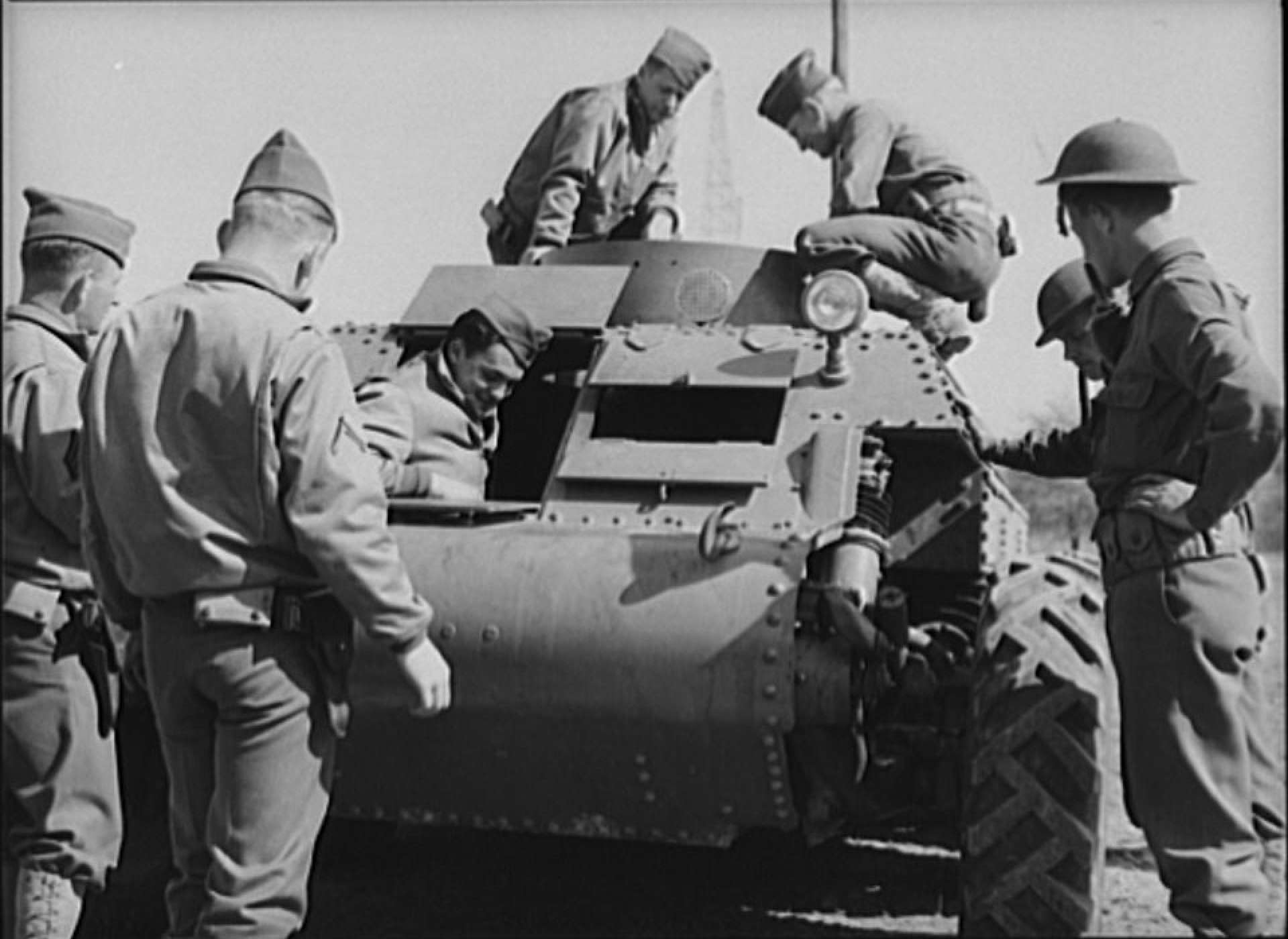 Soldiers inspecting new trackless tank during demonstration at Fort Myer, Virginia, April 1941. Library of Congress