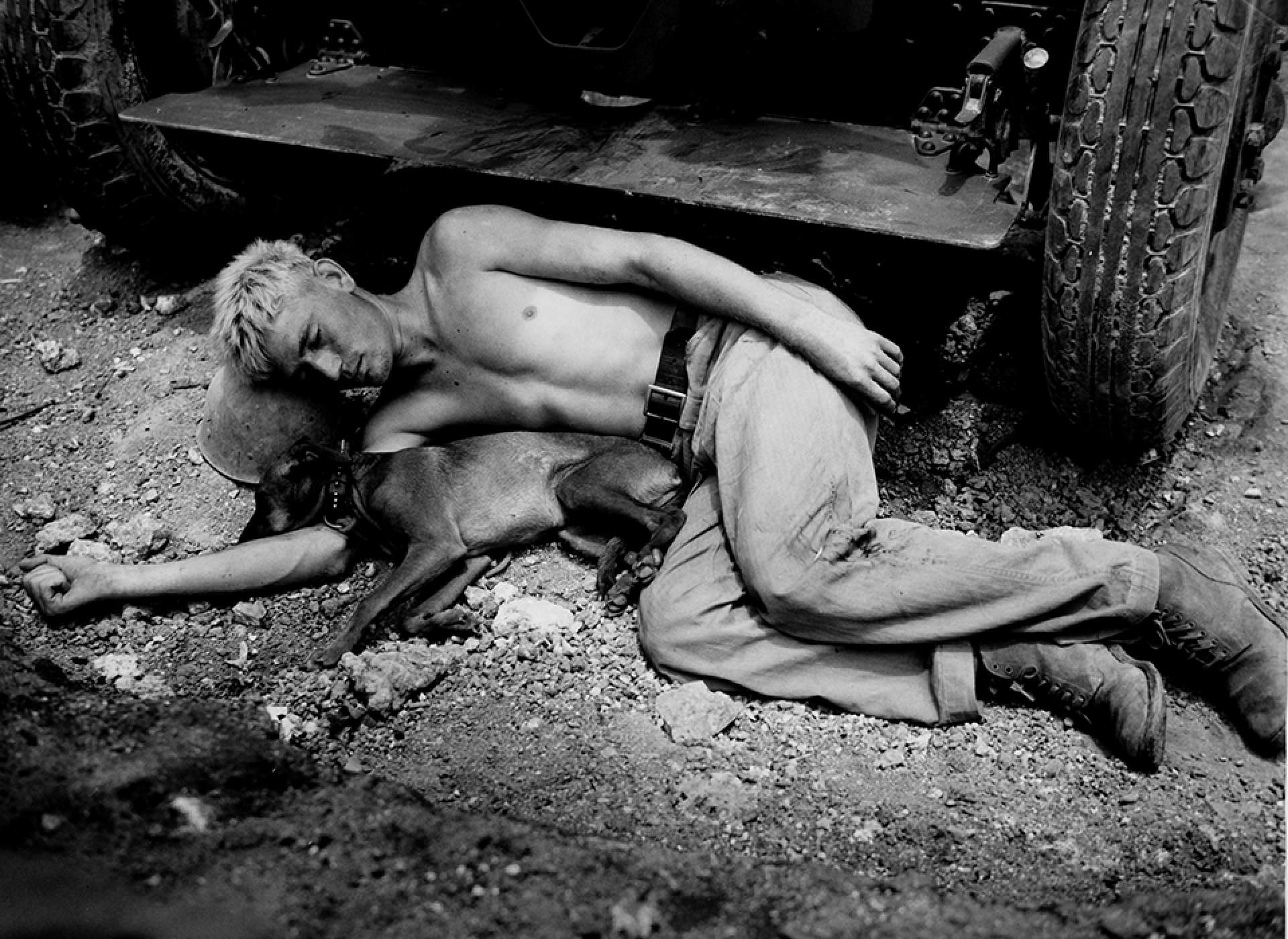 A marine and his dog sleep wherever and whenever possible—here, in a foxhole on Okinawa. Time Life Pictures/Getty Images.