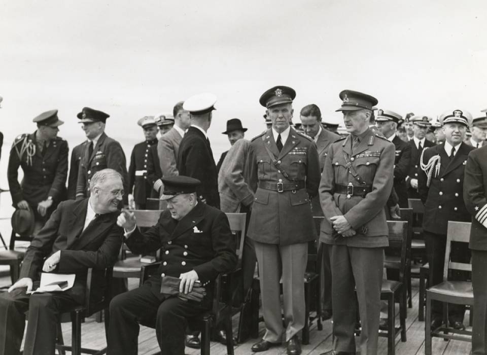 President Franklin Delano Roosevelt and British Prime Minister Winston Churchill meet aboard the HMS Prince of Wales during the Atlantic Conference