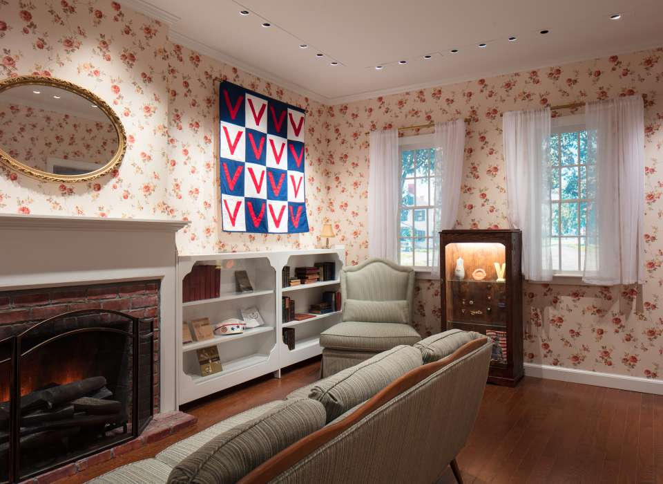 War Affects Every Home gallery, WWII-era living room with Victory quilt, Arsenal of Democracy