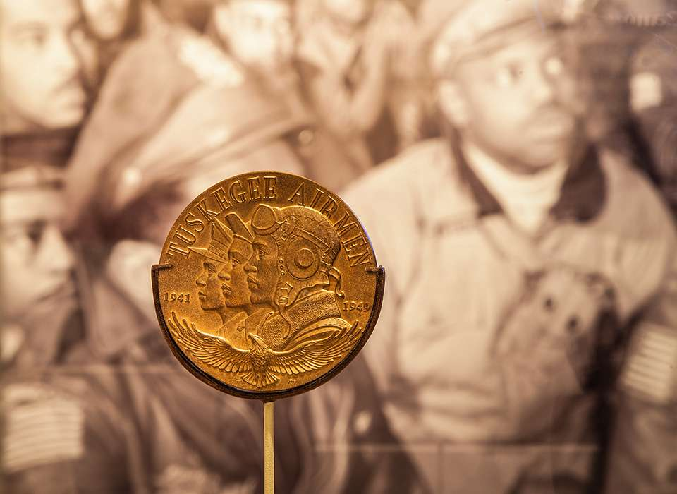 Fighting for the Right to Fight exhibit, Tuskegee Airmen coin
