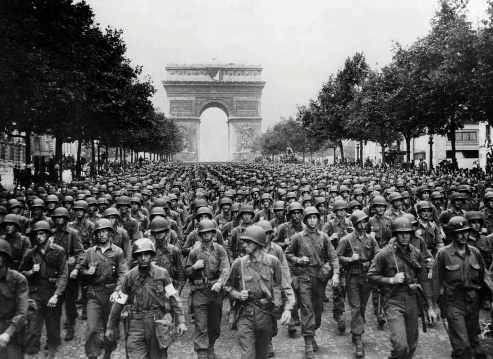 Troops in front of the Arc de Triomphe, Paris, WWII
