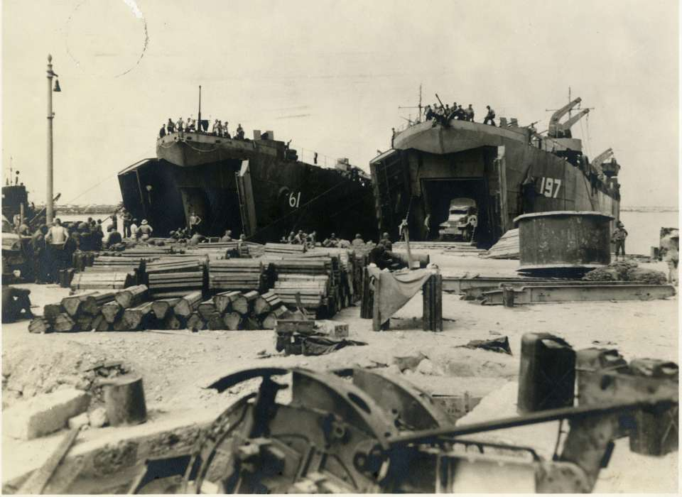 LST-61 [Landing ship, tank] and LST-197 side-by-side on shore at Licata Harbor in Sicily