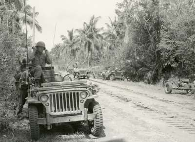 Soldier with radio in Jeep, Pacific theater