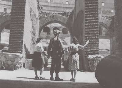 Soldier with people in Coliseum